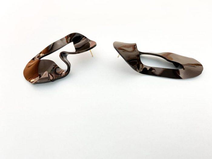 black experimental design earrings